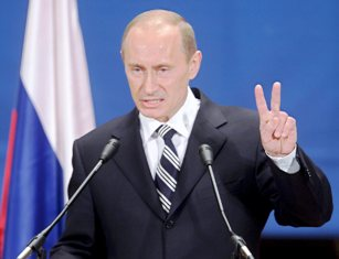 epa01304499 Russian President Vladimir Putin gestures during his news conference following the NATO - Russia Council, Bucharest, Romania, 04 April 2008. Russia won a reprieve from NATO on further eastward expansion, but lost big in the feud with the United States over its plans to deploy a missile defence system in Eastern Europe, Russian newspapers reported Friday.  EPA/YURI KOCHETKOV